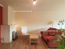 Eigentijds ingericht appartement voorzien van inkomhal met vestiaire, woonkamer met eetplaats, ingerichte keuken met bergruimte/wasplaats en terras...
