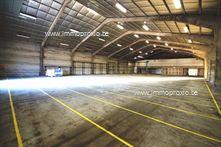 NDELING  : magazijn van 1.200m²  (25m x 48m) met 2 laadkaden. Groot verhard terrein voor -en achter het ge...
